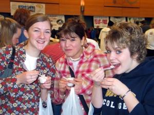 Sampling food 3 girls